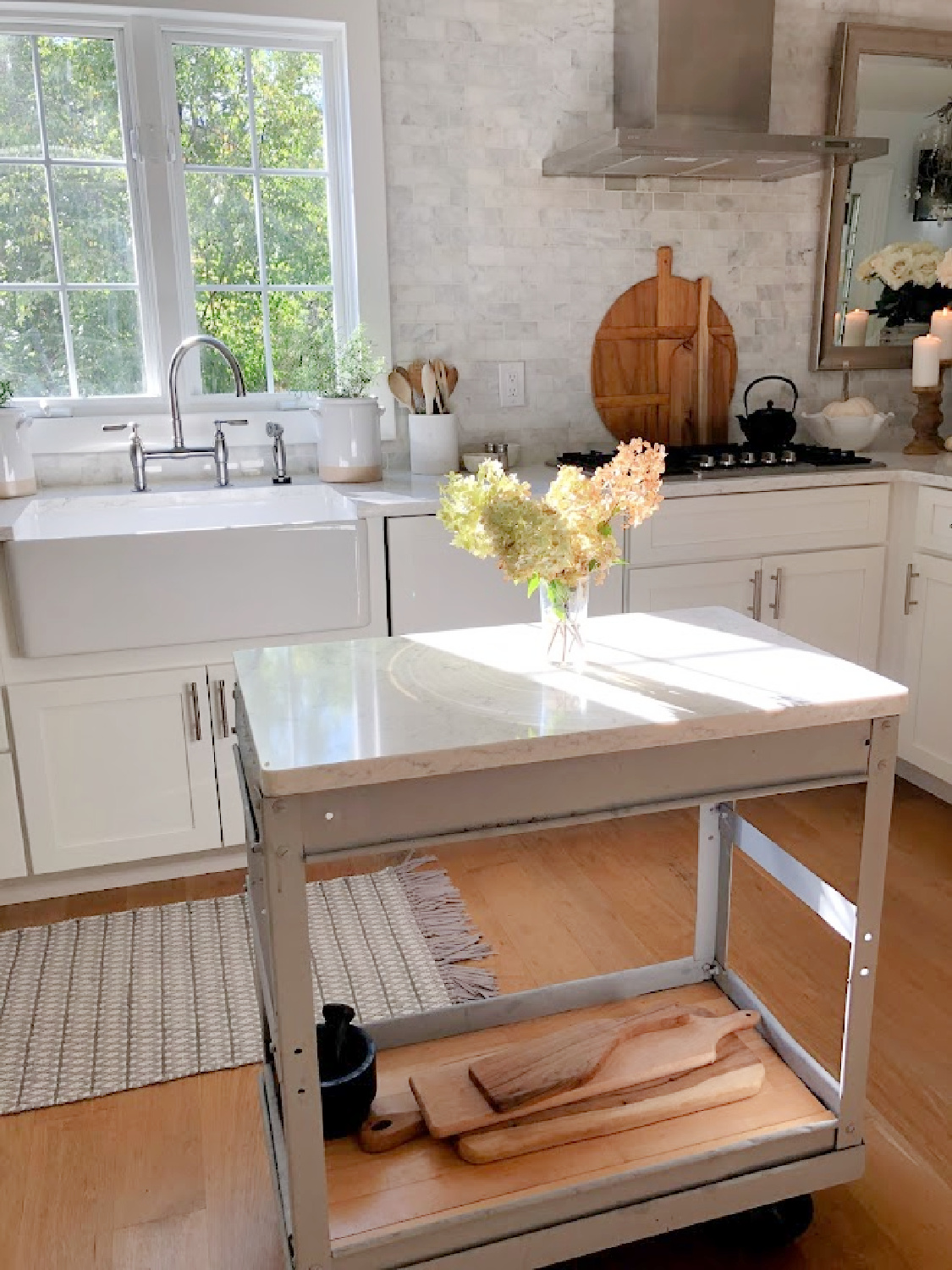Serene white kitchen in early fall with hydrangea - Hello Lovely Studio.