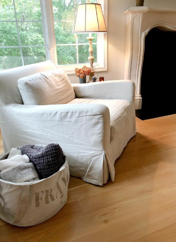 My Belgian linen arm chair in living room with white oak hardwoods - Hello Lovely Studio.