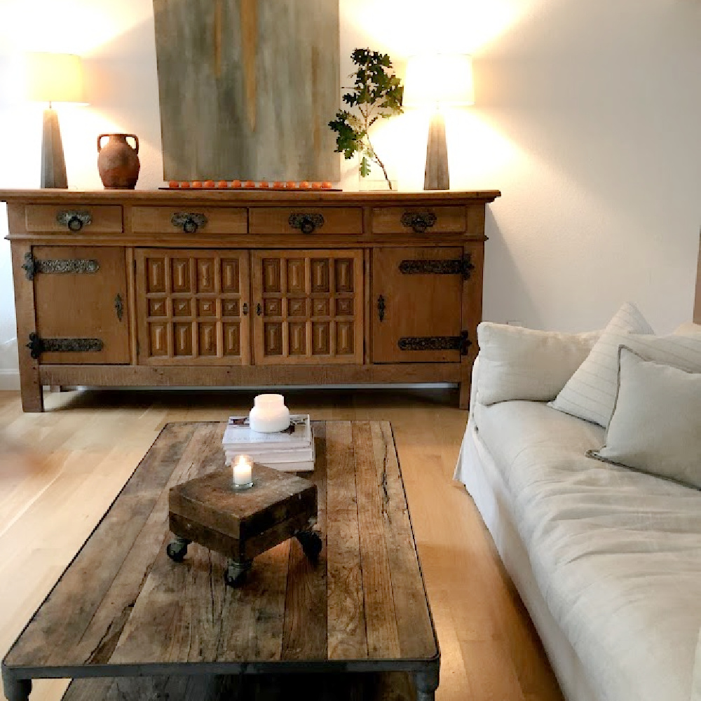 Living room with rustic oak Belgian sideboard and reclaimed elm coffee table - Hello Lovely Studio.