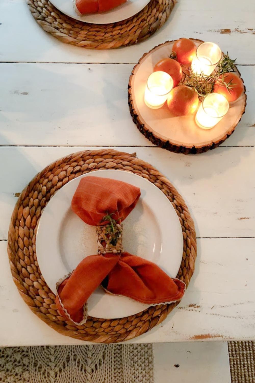 Orange napkins on my white farm table in early fall - Hello Lovely Studio.