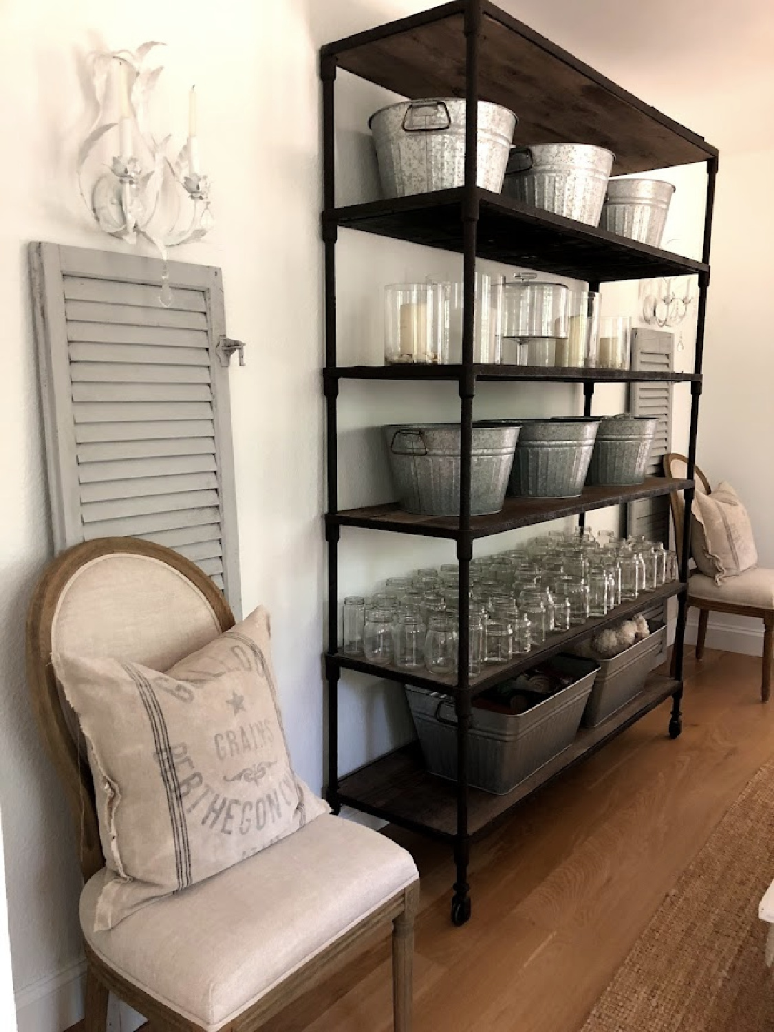 Rustic shelves with galvanized tubs to organize in the dining room - Hello Lovely Studio.