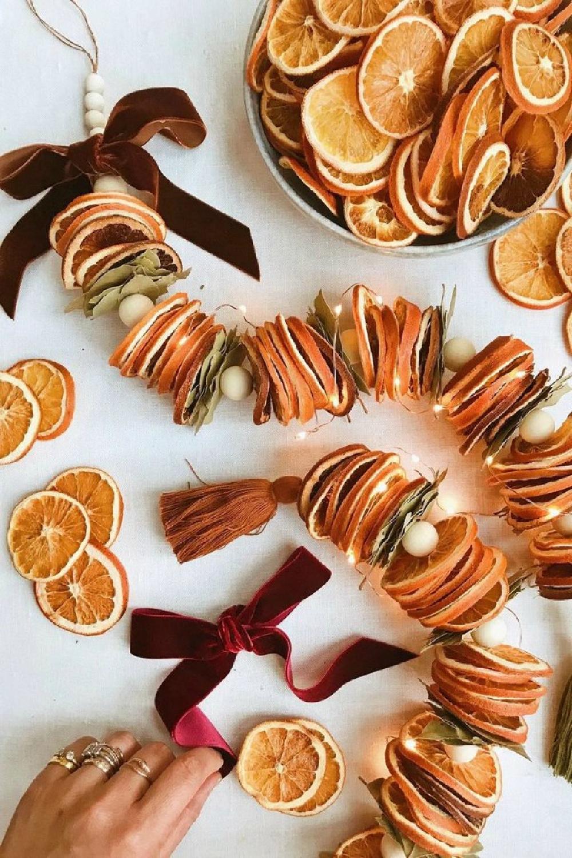 Dried citrus garland from HonestlyWTF. #holidaydecor #christmasdecor #DIY #christmascraft #crafts
