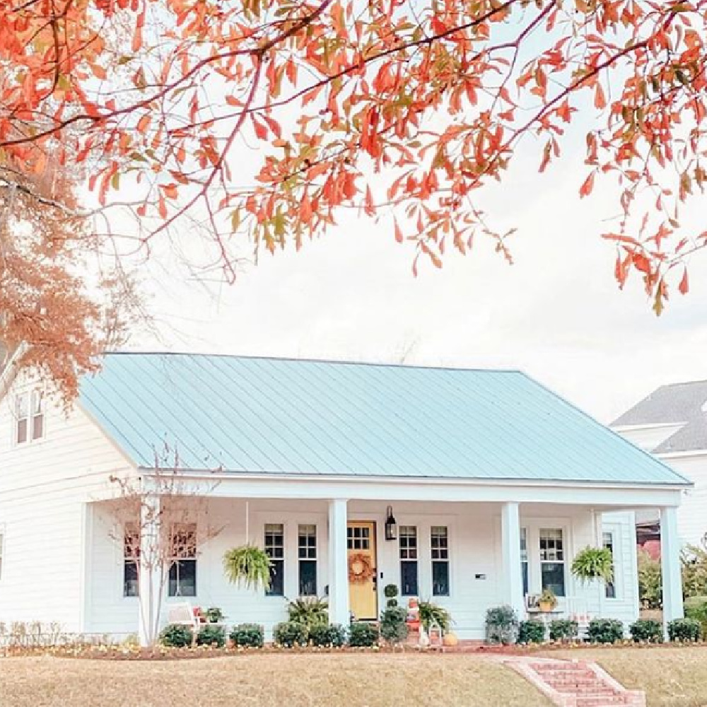 Beautiful white cottage with metal roof in the fall with turning leaves - @simplysoutherncottage. #whitecottages #metalroof