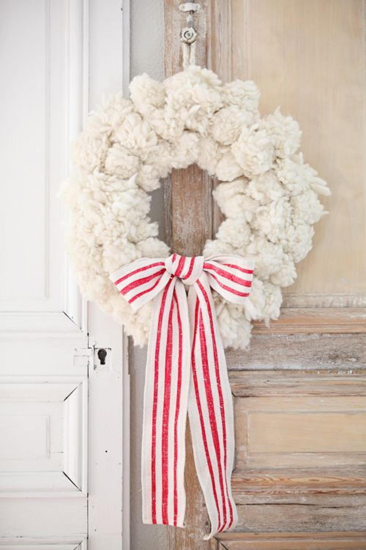 Charming shabby chic white pom pom Christmas wreath with red and white grainsack ribbon -Dreamy Whites. #pompomwreath #christmaswreath #frenchchristmas