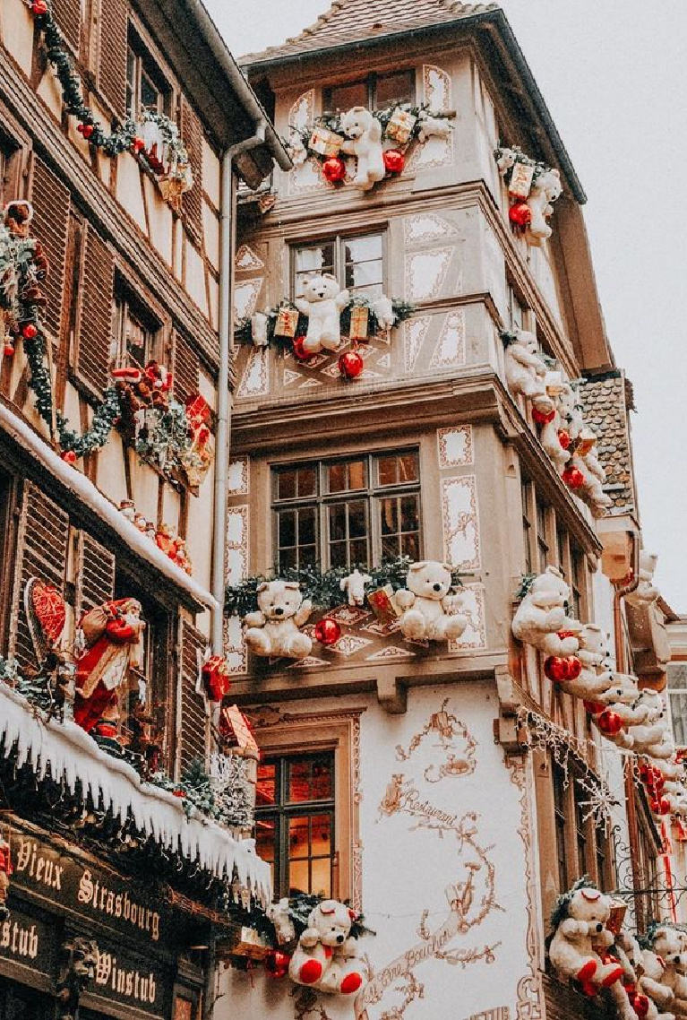 French Christmas decor with huge teddy bears on buildings in Strasbourg, France - Odrida. #frenchchristmas #christmasdecor #holidaydecor #frenchholiday #christmasdecorating #teddybears