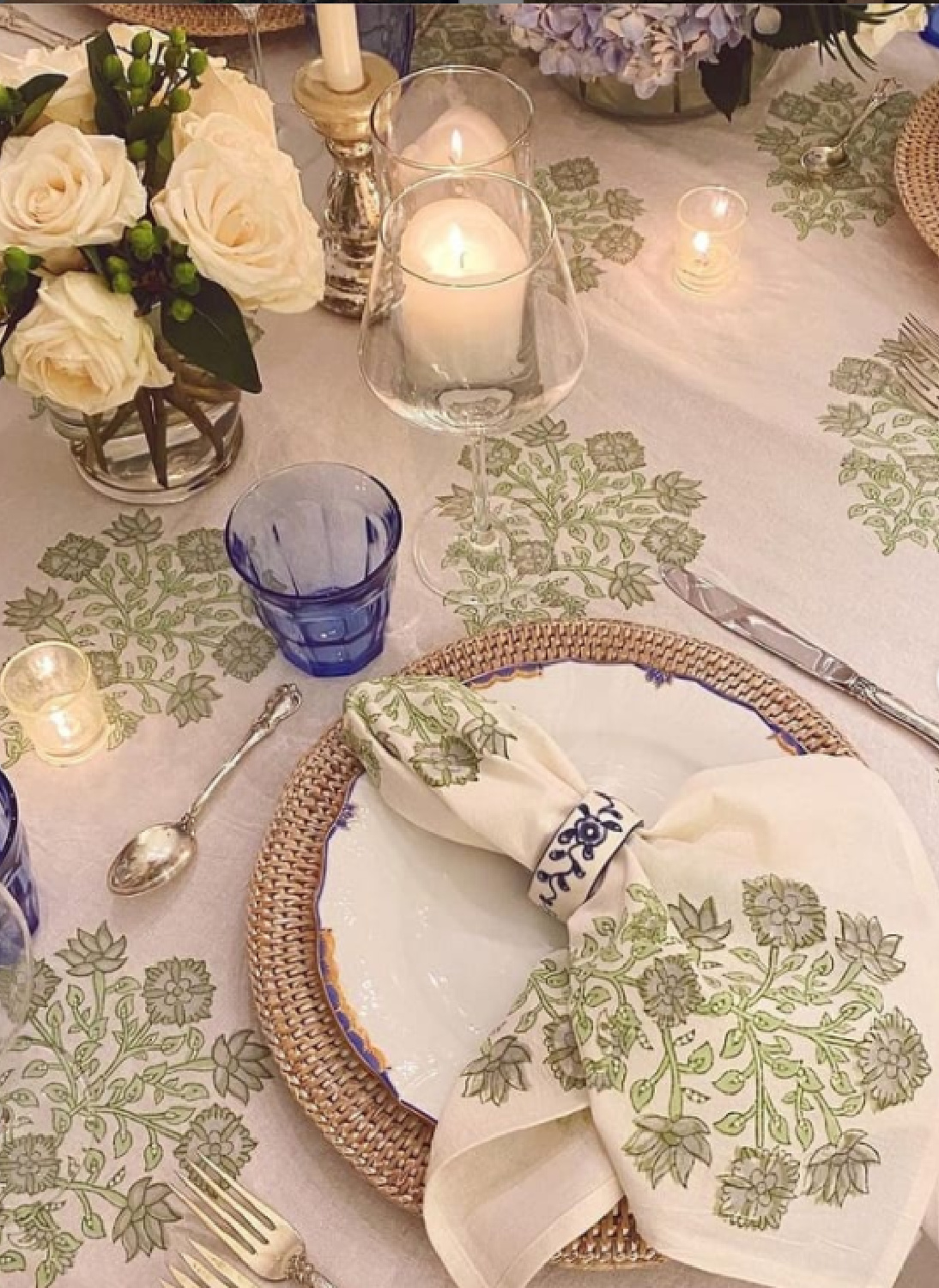 Beautiful Christmas place setting and holiday table with soft green and blue accents - @meganstokes. #holidayplacesetting