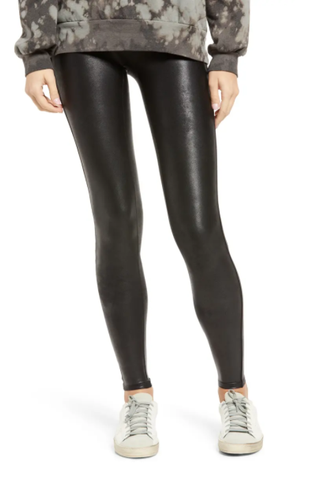 Spanx faux leather leggings with white sneakers.