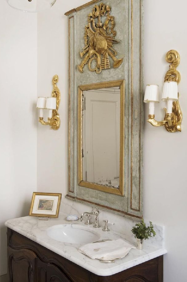 Elegant and luxurious French country bathroom in Provence - @provencepoirers. #frenchcountry #bathroomdecor #antiques #oldworldstyle #trumeau #provencestyle #interiordesign