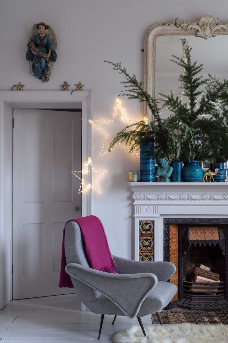 French country Christmas decorated living room with fireplace and blue accents - Farrow & Ball. #frenchcountry #christmasdecor #bluechristmas #frenchchristmas