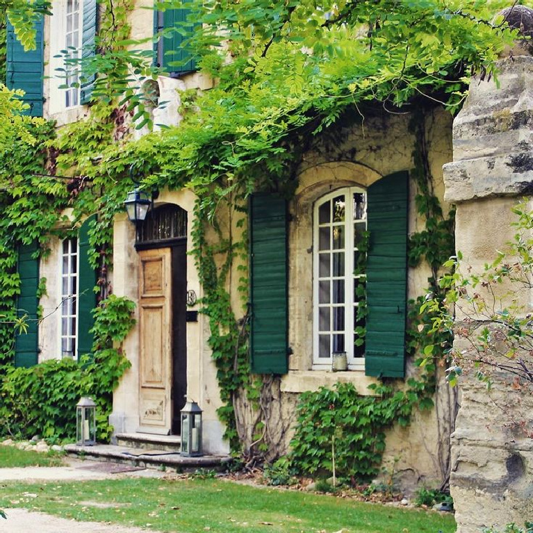 Brethtaking French country home exterior with climbing vines, rustic stone and shutters, and Old World style - @adornedcottage. #frenchcountry #exteriors #frenchhome #rusticfrench #romanticfrenchcountry #frenchcountryside
