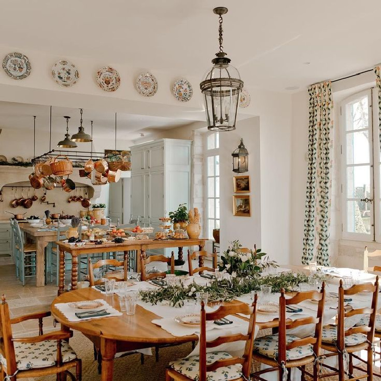 French farmhouse kitchen and dining area in a Provence chateau ( light blue cabinets and copper pots from E. Dehllerin) - @provencepoirers. #frenchkitchen #frenchfarmhouse #frenchchateau #copperpots #frenchfarmhousekitchen #lightblue #provencekitchen #provencepoirers