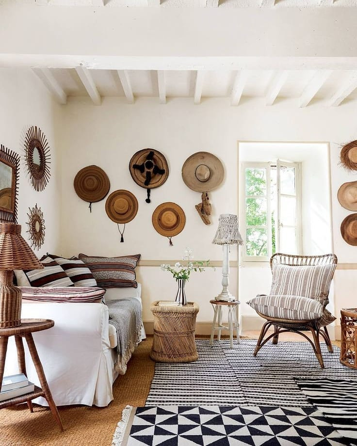 Rustic refined living room in France (Luncinda Chambers) with charming straw hats on wall - @houseandgardenuk. #frenchcountry #frenchrustic #rusticrefined #livingroom #interiordesign #livingrooms #rusticdecor