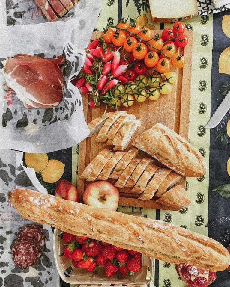 Glorious French countryside picnic with bread and charcuterie - @thetravelmuse. #frenchpicnic #frenchcountry #charcuterie #frenchcountryside #frenchfall