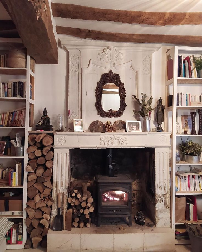 Rustic French country interior with fireplace and bookshelves - @lafermederce. #frenchcountry #rusticrefined #oldworldstyle #frenchfireplace #frenchfarmhouse #interiordesign