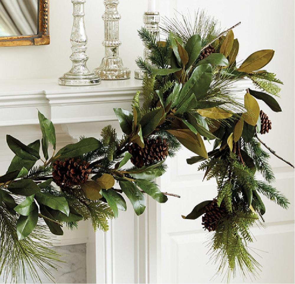 Faux evergreen garland with magnolia and pinecones - Ballard Designs. #holidaydecor #garlands