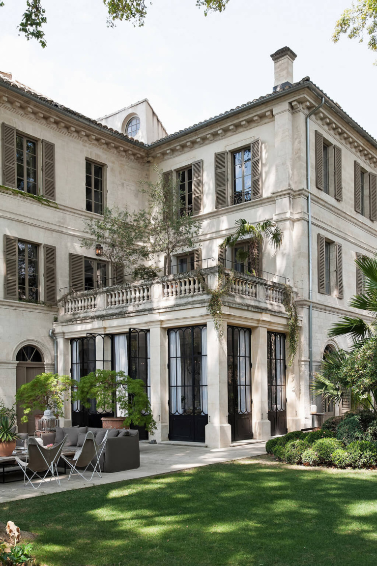 Romantic and luxurious exterior of a French chateau (Avignon Hôtel Particulier), a beautifully restored 19th century mansion in the heart of the town's historic center - Haven In. #frenchcountrydecor #frenchchateau #provence #frenchcountry #restoredchateau #southoffrance #aivgnonhotel