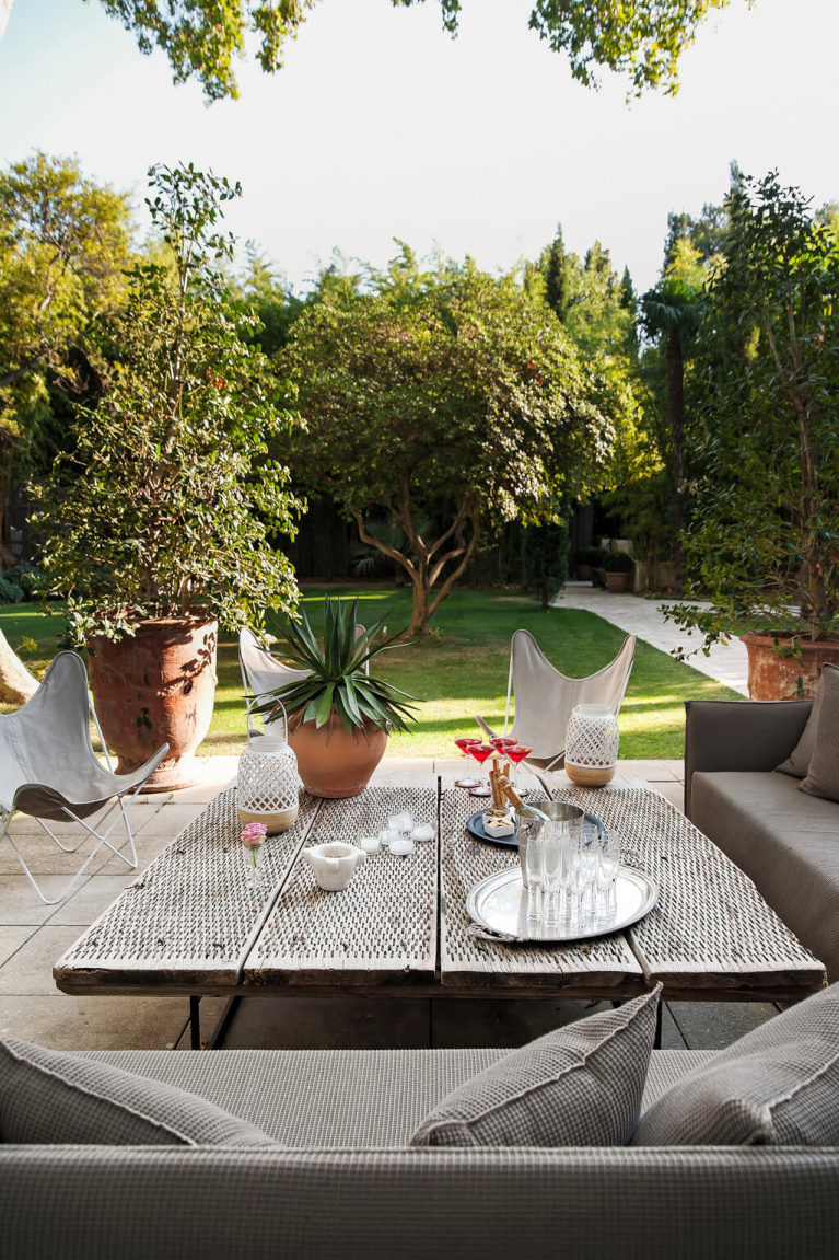 Romantic modern French terrace with butterfly chairs at Avignon Hôtel Particulier, a beautifully restored 19th century mansion in the heart of Avignon's historic center - Haven In. #modernfrench #frenchterrace #frenchcountrygarden #frenchchateau #provence #frenchcountry #restoredchateau #southoffrance #aivgnonhotel