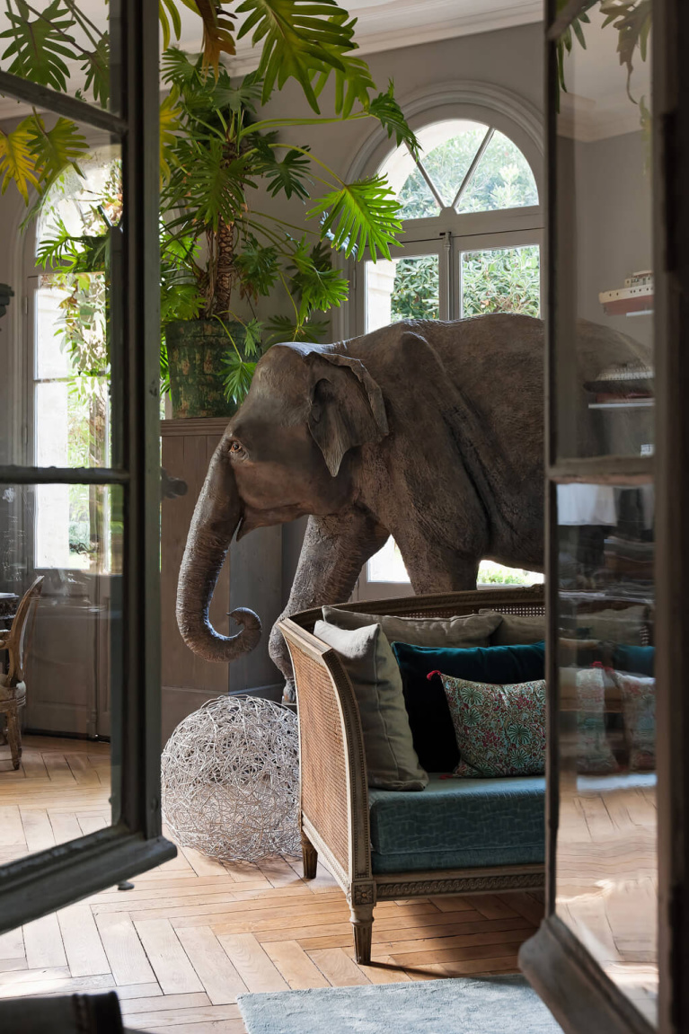 Eclectic and dramatic art collection including lifesize elephant in Avignon Hôtel Particulier, a beautifully restored 19th century mansion in the heart of Avignon's historic center - Haven In. #modernfrench #frenchcountrydecor #frenchchateau #provence #frenchcountry #restoredchateau #southoffrance #aivgnonhotel