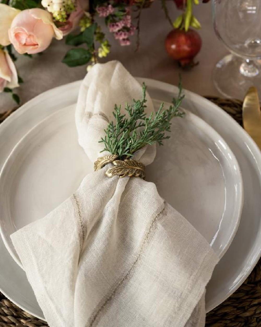 Simple and natural Christmas holiday placesetting with brass napkin ring, fresh greenery, and cloth napkin - McGee & Co. #holidaytable