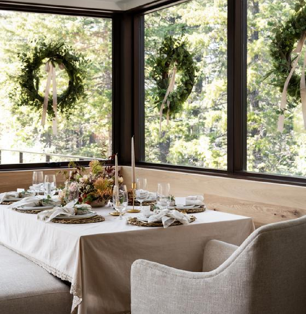 Natural and serene Christmas holiday table with wreaths on window and fall floral centerpiece - McGee & Co. #holidaytable