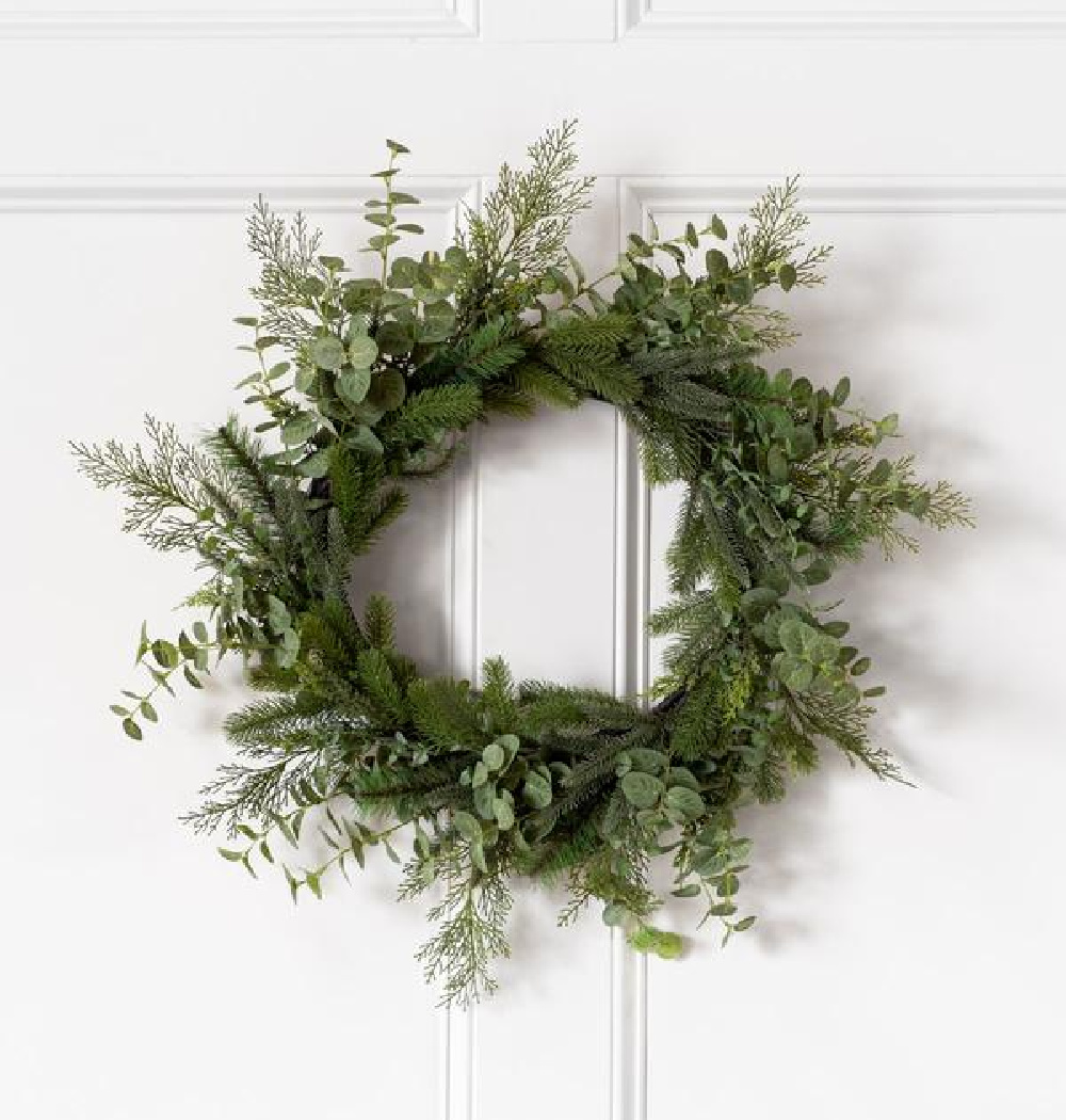 Evergreen faux wreath on a white door - McGee & Co.
