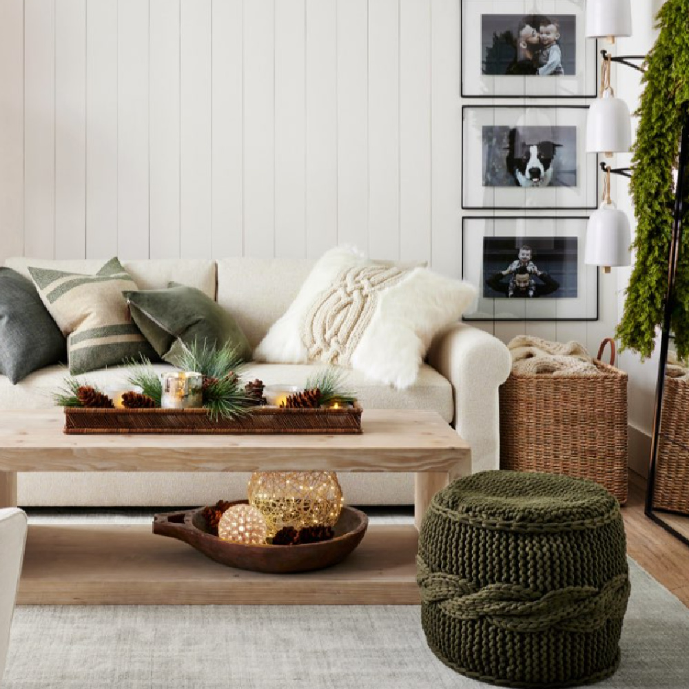 Green accents in a laid back and natural family room - Pottery Barn. #holidaydecor #greenandwhite #naturalchristmas
