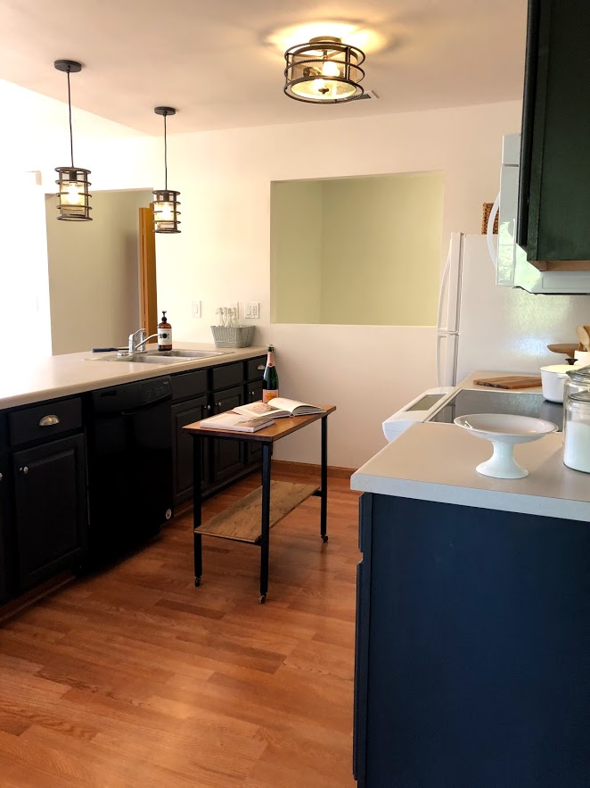 A budget friendly condo renovation with Gladstone Oak laminate flooring and Sherwin Williams Carbonized paint playing starring roles.