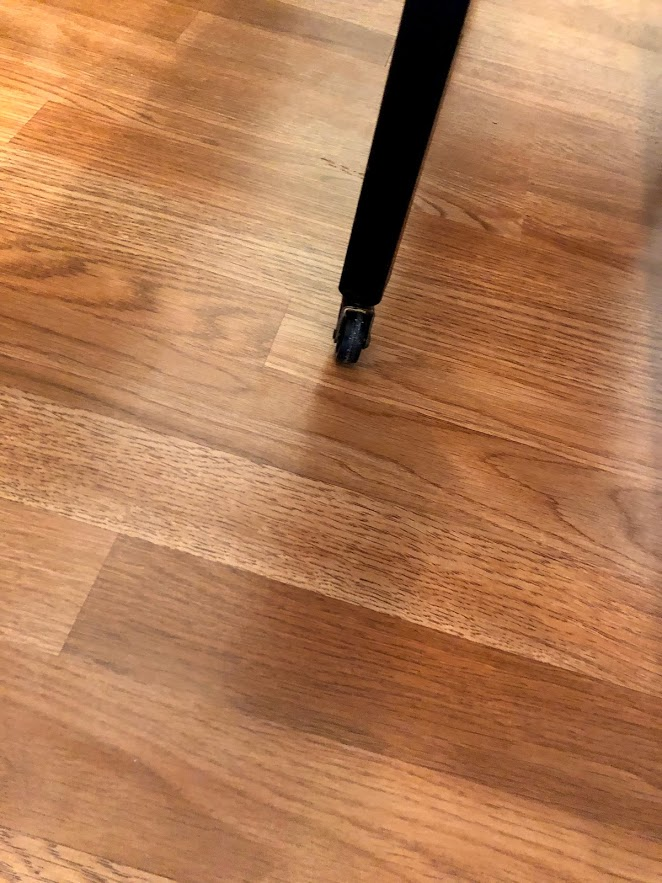 Detail of Gladstone Oak laminate flooring in a condo renovation.
