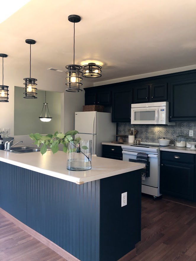 Kitchen cabinets were painted #sherwinwilliamscarbonized in this condo renovation.