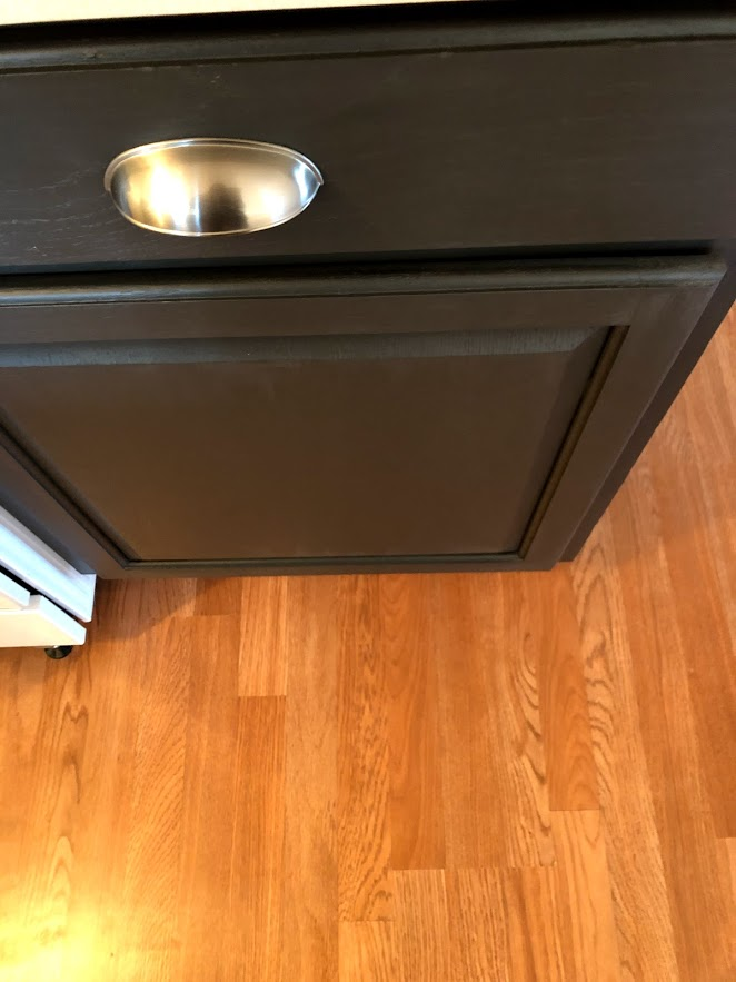 Sherwin Williams Carbonized painted kitchen cabinet.