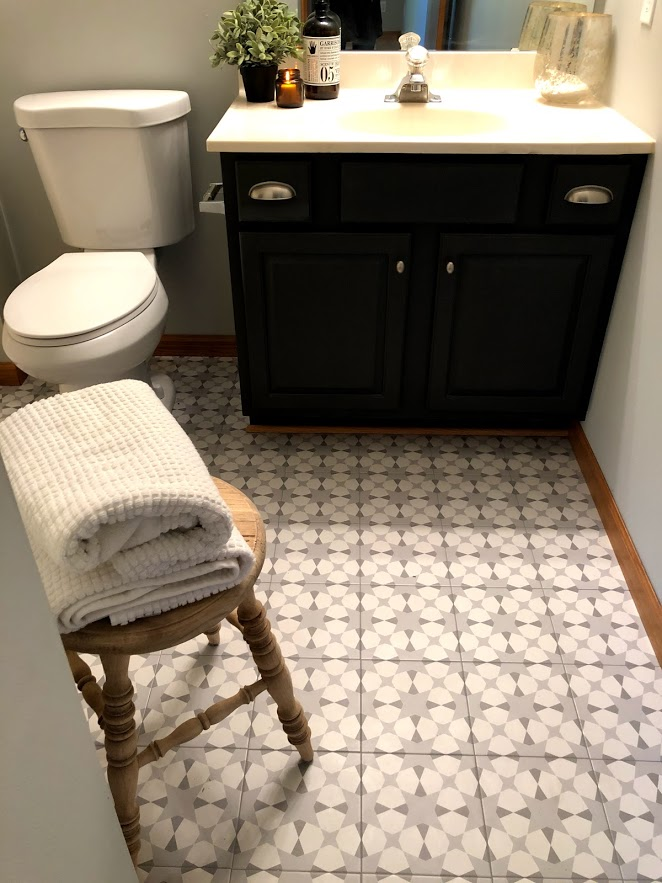 Modern farmhouse style tile in the bathroom only looks like cement - it's an inexpensive porcelain tile that adds personality and charm.