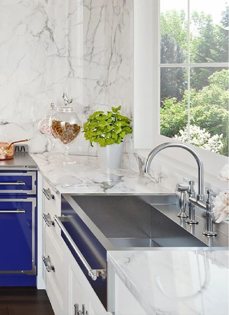 Custom stainless steel apron front sink from L'Atelier Paris is a glorious bespoke option for a luxurious kitchen with white marble and blue French range. #apronfront #kitchensink #bespokekitchen #frenchkitchen