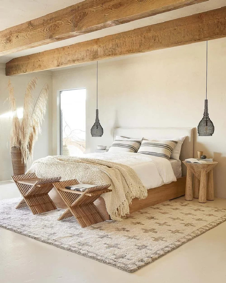 Natural zen rustic Scandi inspired bedroom with rugged wood beams and neutral colors - Planetedeco.