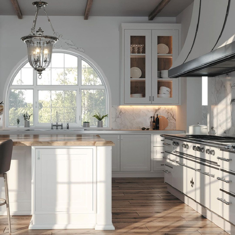 Bespoke French country kitchen with luxurious range and arched window over sink - L'Atelier Paris. #frenchkitchen #frenchcountrykitchen #luxurykitchen #dreamkitchen #bespoke