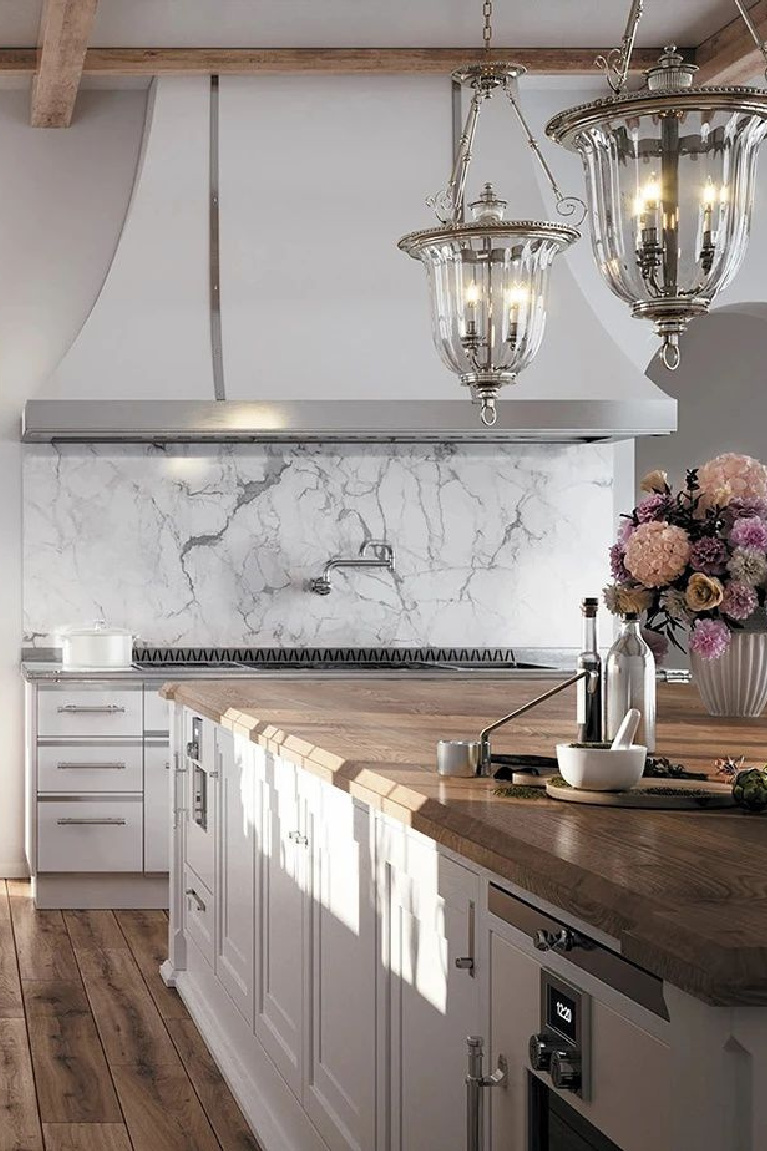 Custom and luxurious white French country kitchen by L'Atelier Paris. #frenchkitchen #customkitchen #luxurykitchen #frenchcountrykitchen