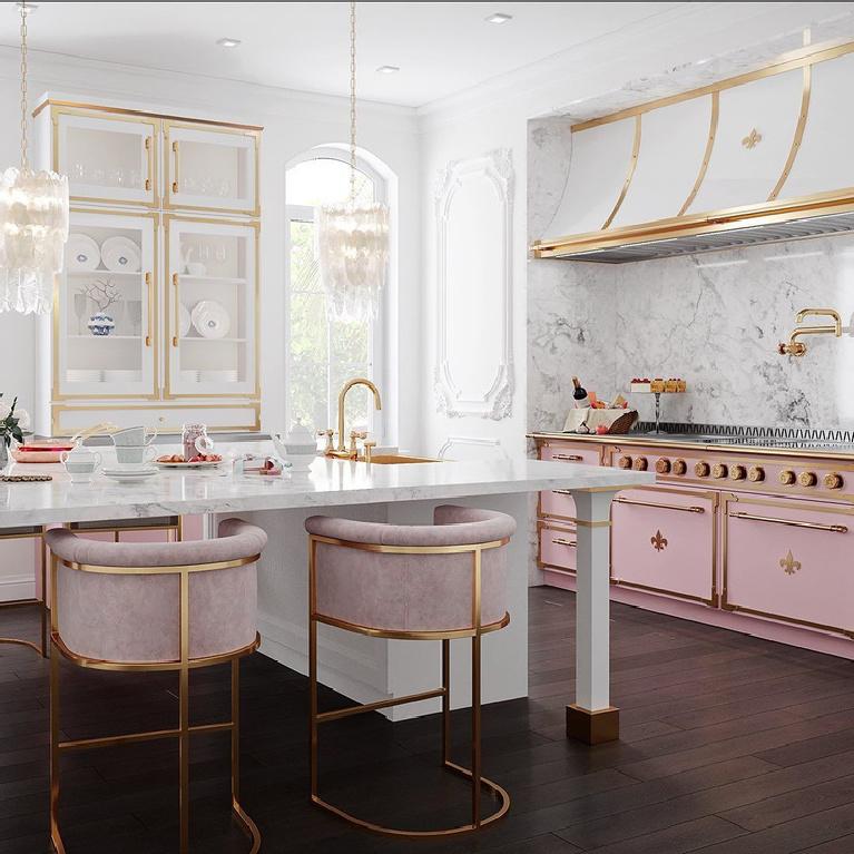 Luxurious pink French country bespoke kitchen by L'Atelier Paris. #pinkkitchen #luxuriouskitchens #bespoke #frenchrange