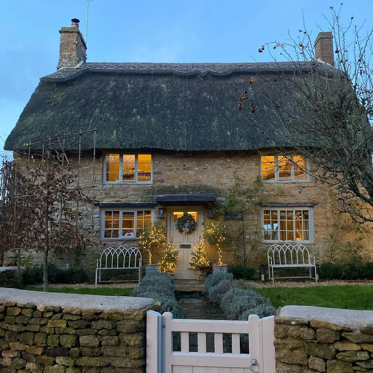 A fairytale stone cottage decorated for Christmas - @osborninteriors