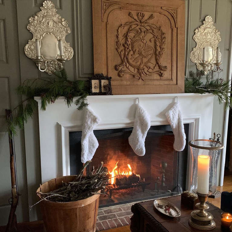 French Christmas decorated space with fireplace and stockings - @marchionesshg