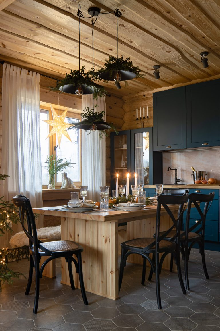 Christmas decor in a European kitchen with modern rustic blue cabinets - Ekaterina Pozdeev.