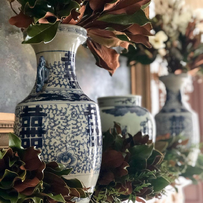 Blue and white porcelain on a mantel decorated for Christmas - @theenchantedhome