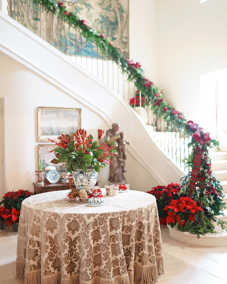 Provence Christmas decor in a grand chateau with garland on staircase - @provencepoirers. Enjoy Glorious 2020 Holiday Decorations & Inspiring Quotes for 2021 Now!