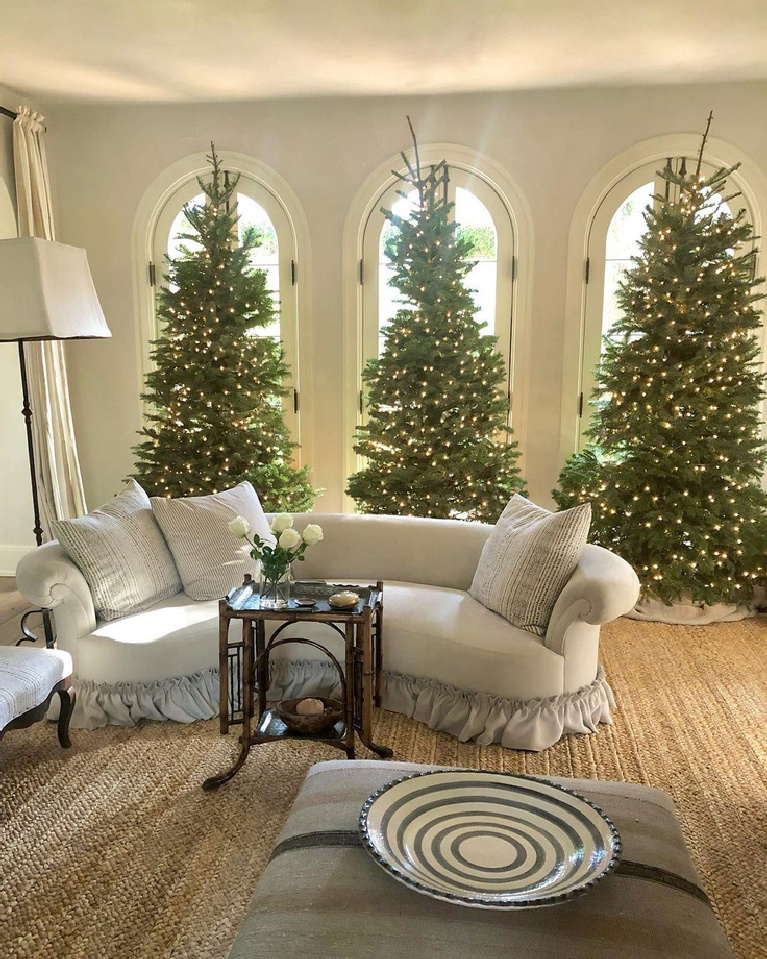 A trio of Christmas trees and arched windows in the lovely living room of Pamela Pierce of Milieu. Enjoy Glorious 2020 Holiday Decorations & Inspiring Quotes for 2021 Now!