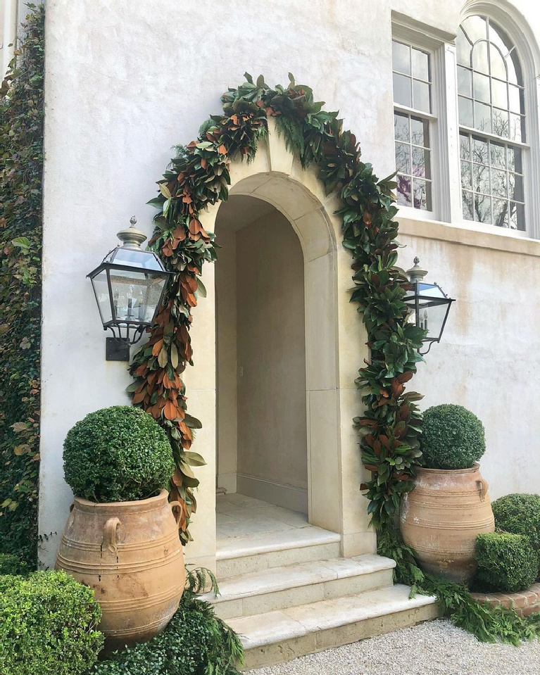 Elegant exterior Christmas decor with a French country feel by Pamela Pierce of Milieu. Enjoy Glorious 2020 Holiday Decorations & Inspiring Quotes for 2021 Now!