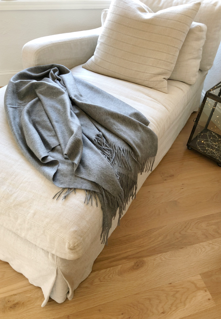 Belgian linen upholstered chaise (RH) with a heather gray cashmere throw (Italic) in my living room - Hello Lovely Studio.