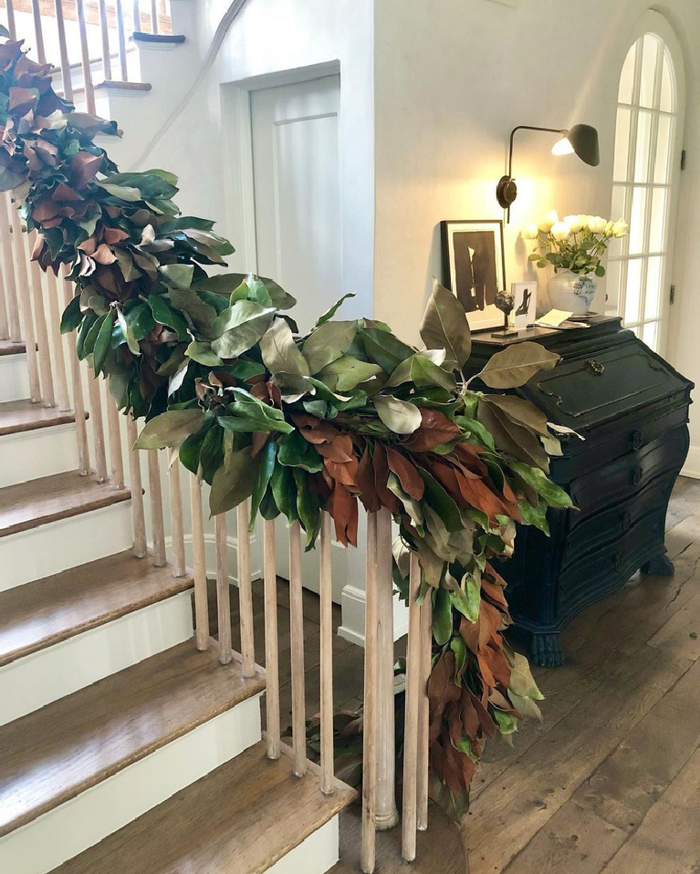 Elegant Christmas decorated staircase with magnolia garland in Pamela Pierce's Houston home - Milieu magazine. Enjoy Glorious 2020 Holiday Decorations & Inspiring Quotes for 2021 Now!