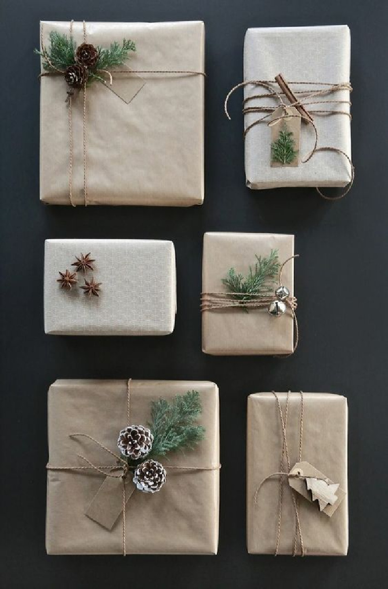Simple Christmas giftwrap idea with brown kraft paper, twine, pinecones, and simple embellishments for a Scandinavian holiday feel - Freshideen.