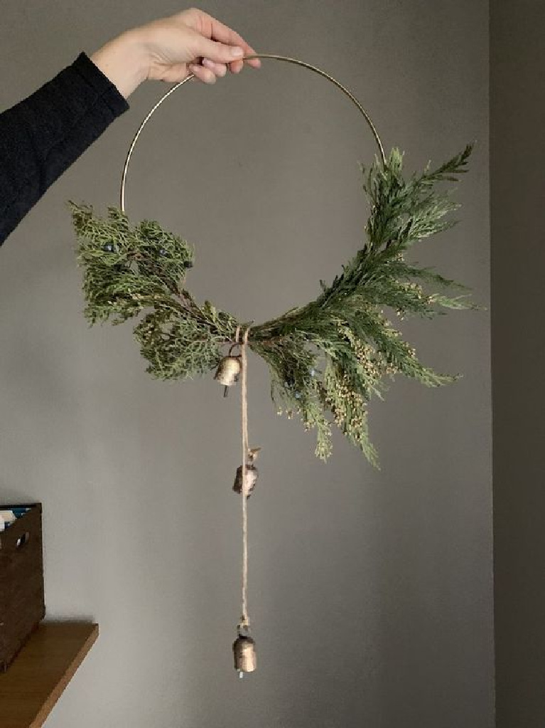 Modern Scandi hoop wreath for Christmas decor with a Swedish feel - natural greenery and sweet gold bells - Allisa Jacobs.