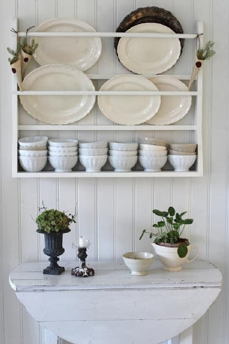 Gorgeous rustic white Swedish country plate rack, ironstone, and simple Scandi Christmas cones - Lillablanka.