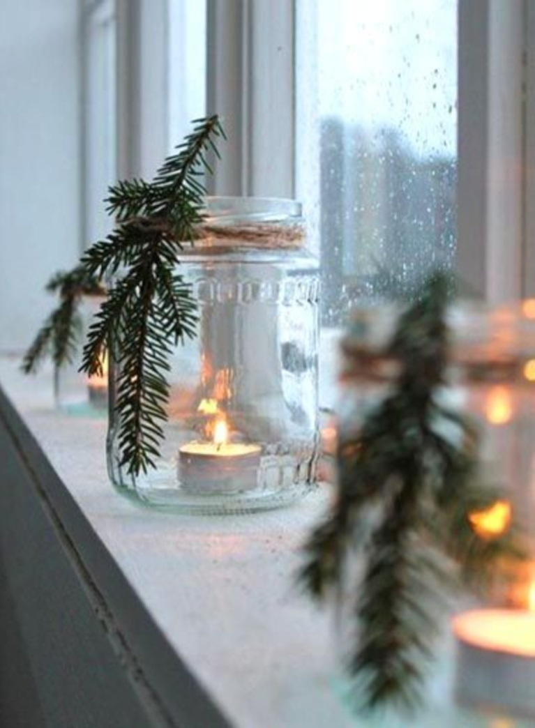Simple yet lovely Scandi Christmas decor idea with glass jar, greenery, twine, and votive candle in window - Zolushka-new.