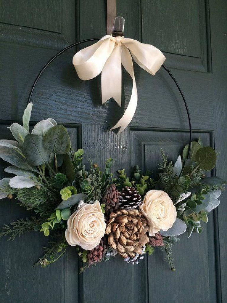 Gorgeous winter wreath on a teal door - roses, pinecones and eucalyptus combine for a striking Scandinavian style Christmas vibe - Truloveblooms on etsy.